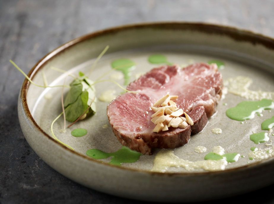 Iberico pork collar, lemon crème fraiche, chamomile onions, chervil sauce and topped with toasted hazelnuts